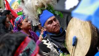 Mapuche Indian activists take part in a rally against Columbus Day in downtown Santiago, Chile October 9, 2017.