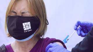 Shanyu Ye receives a Covid-19 vaccination dose outside the Karsh Family Social Service Center on March 18, 2021 in Los Angeles, California.