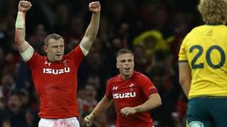 Wales backs Hadleigh Parkes and Gareth Anscombe celebrate beating Australia