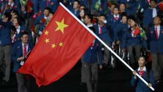 Flag bearer Rong Jing of China leads the team entering the stadium during the Opening Ceremony of the Rio 2016 Paralympic Games at Maracana Stadium on 7 September 2016 in Rio de Janeiro, Brazil.