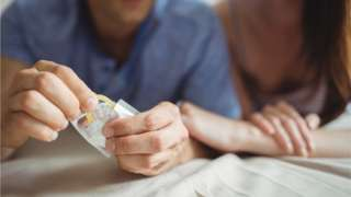 Couple with condom