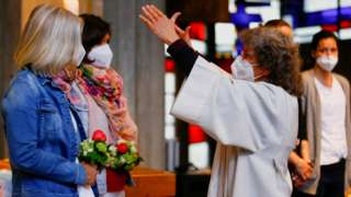 Pastoral worker Brigitte Schmidt blesses the same-sex couple Nini and Juliana Weinmeister during a ceremony in a Catholic church in Cologne, Germany, May 10, 2021
