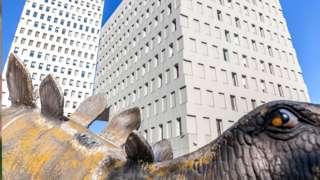 Dinosaur statute outside Ibis hotel in Santa Coloma de Gramenet