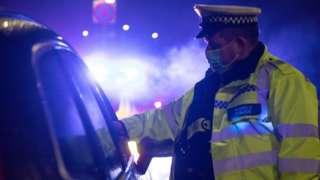 policeman stops car in Wales