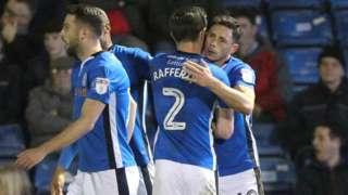 Rochdale celebrate Ian Henderson's goal