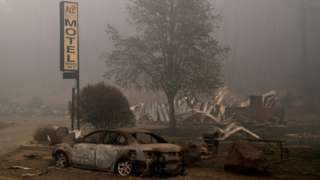 The remains of a fire damaged vehicle and a motel in the aftermath of the Beachie Creek fire in Detroit, Oregon, US, 14 September 2020