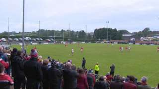 Crowds at the Derry GAA final, seen from behind