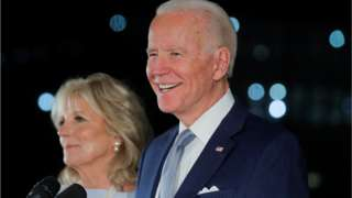 Joe Biden smiles as he speaks with his wife Jill at his side during a primary night news conference at The National Constitution Center in Philadelphia, Pennsylvania, 10 March 2020