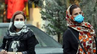 Women wearing face masks stand on a street in Tehran, Iran (6 October 2020)