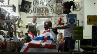 A man has his hair cut at Oscar's Barber Shop on Walworth Road on November 02, 2020 in London