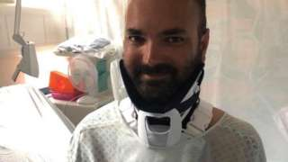 man in neck brace