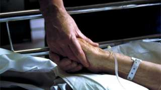 Nurse holds a hand