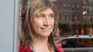 Vermont Democratic Party gubernatorial primary candidate Christine Hallquist, a transgender woman, poses on College Street in Burlington, Vermont