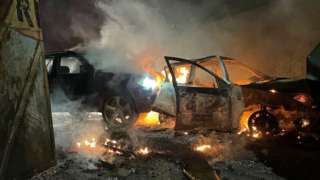 Burning cars on a street in west Belfast