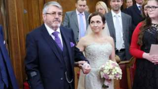 John Kendrick walking his daughter Nicky down the aisle