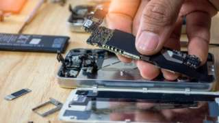 Person fixing a phone