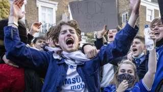 Chelsea fans celebrate the verdict