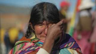 An indigenous woman prays and cries during a blockade to a Yacimientos Petroliferos Fiscales Bolivianos (YPFB) oil refinery