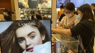 Tourists spend money at a lancome cosmetics store in Haikou, South China's Hainan Province, 2 September 2021.