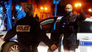 Police officers secure the area near the scene of a stabbing attack in the Paris suburb of Conflans-Sainte-Honorine, France. Photo: 16 October 2020.
