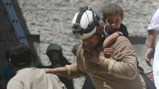 White Helmet rescues child