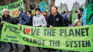 Protesters seen holding banners during the demonstration. Extinction Rebellion held a lock-down of Edinburgh's North Bridge as part of an international movement. Police Scotland made around 30 arrests over the course of the day as a result.
