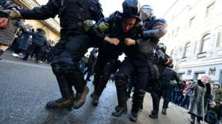 Riot police detain a man during a rally in support of jailed opposition leader Alexei Navalny in the far eastern city of Vladivostok on January 23, 2021