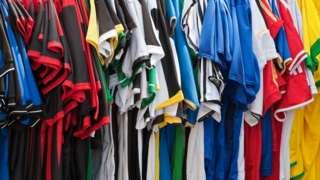 Football shirts on a rack
