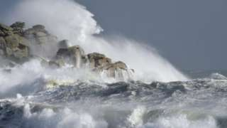 Waves hitting rocks