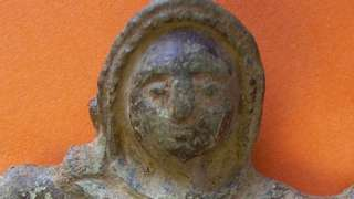 the Roman figurine can be