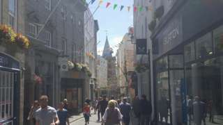 St Peter Port high street with people shopping