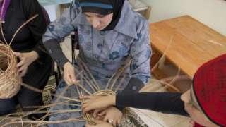 Israeli Arab women making baskets in Nazareth