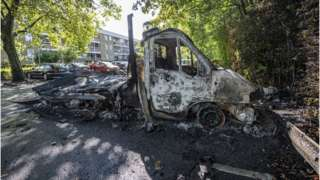 A burnt out light truck pictured a day after the riot in the Rosengard neighbourhood of Malmo, Sweden, 29 August 2020.