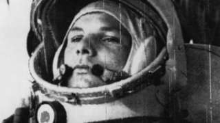 Yuri Gagarin wearing a space helmet