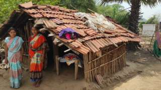 Women of Kanal Tola outside their period hut