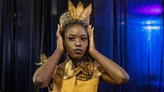 A model gets ready in the backstage area during the third edition of East Africa International Fashion Week in Nairobi, on October 16, 2021. - The annual fashion event created by a former Kenyan model attracts fashion enthusiasts and buyers to see six different collections by designers from Kenya, Uganda and Tanzania.