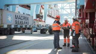 Maersk crew handling customs clearance at a port