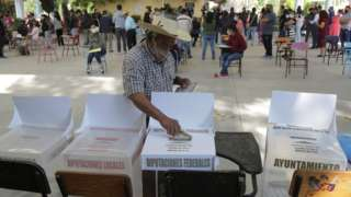 A man votes in Mexico