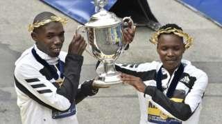 Benson Kipruto and Diana Kipyogei celebrate their victories in the Boston marathon