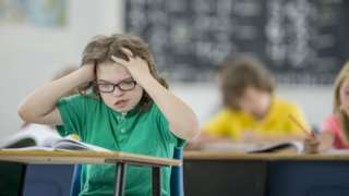 Child with learning disability is frustrated in class