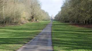 View to the east along Broad Ride in Cirencester Park, aligned with the tower of the Church of St John the Baptist.