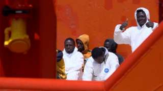 Migrants on board the tug boat