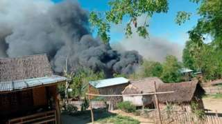 Images obtained on social media show the fire in Kin Ma village