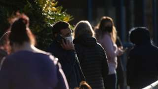 Man in a mask on the phone