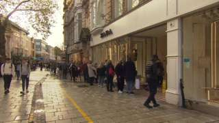 People queuing outside a shop in Cardiff