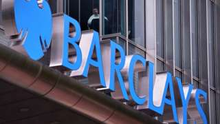 Man looks out of Barclays office