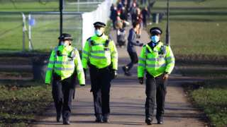 Police officers patrolling Clapham Common in London