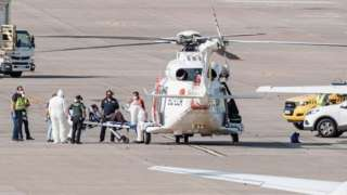 A woman is evacuated in helicopter after being rescued in Telde, Gran Canaria, Canary Islands, Spain, 19 August 2021