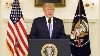 A still image taken from video provided on social media on January 8, 2021. Donald Trump via Twitter. US President Donald Trump gives an address, a day after his supporters stormed the US Capitol in Washington,