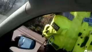 A still from the video after the driver was pulled over